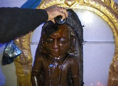 Lord Shani being offered mustard oil