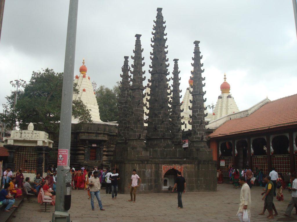 deepastambha stone column for lamps at mahalakshmi temple kolhapur.