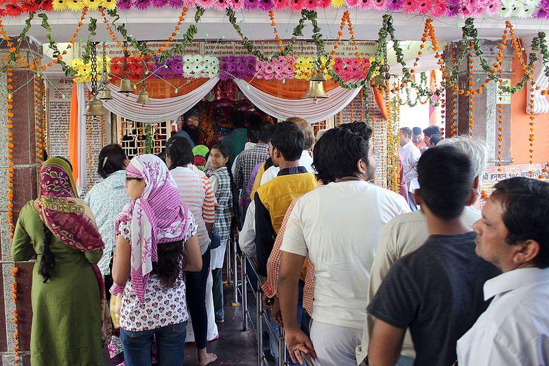 Devotees worshipping Lord Hanuman on Hanuman Jayanti