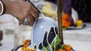 Pouring Milk on Shiva Lingam