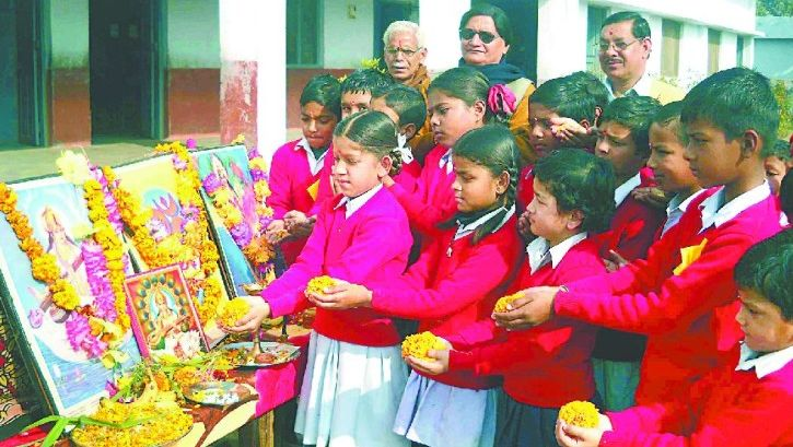 Children paying tribute to the goddess on Basant Panchami.