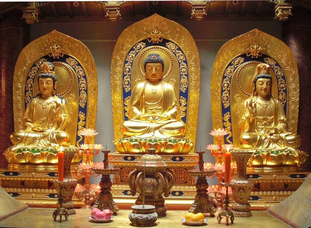 Three golden idols of Lord Buddha