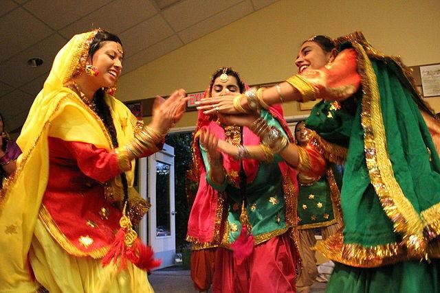 Women Dancing During Teej