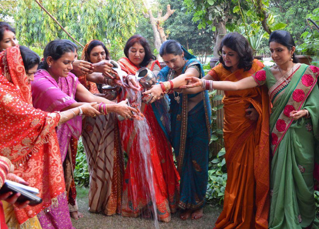 Women performing Karva Chauth festival during kartika month