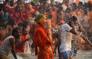 Hindus bathing in the sacred river on Kumbh Mela