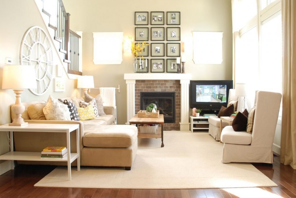Living room with fire place and wall portrait (Vastu tips for living room)