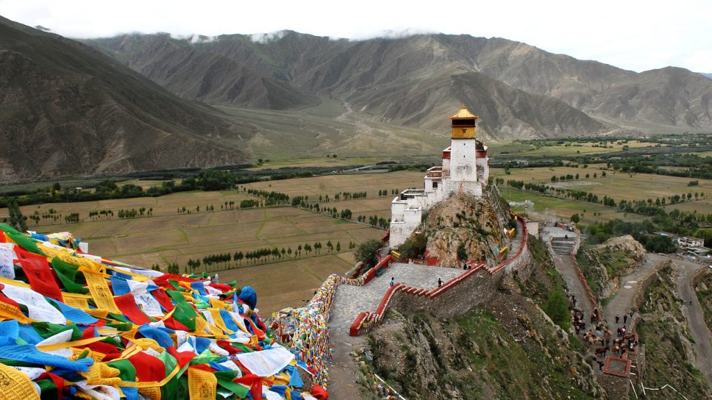 Tibetan Monastery surrounded by fields and mountains