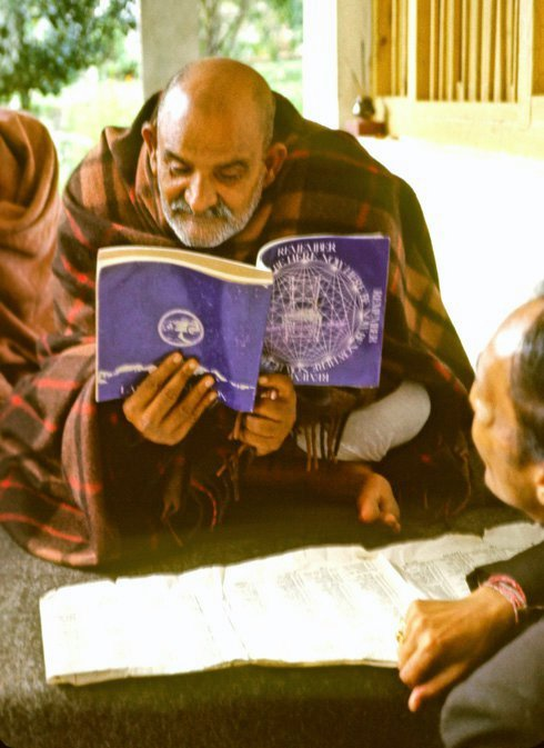 Baba Reading The Book 'Be Here Now' Written By His Disciple Ram Dass